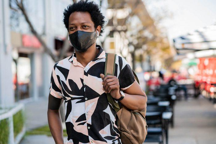man walking outdoors street